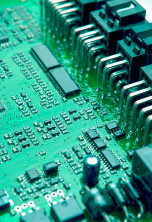 printed circuit: Closeup of Printed Circuit Board with Mounted Components. Vertical Image Orientation Stock Photo