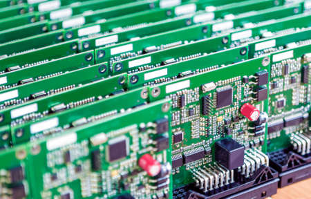 electrolytic: Printed Circuit Boards Placed in Lines Together  with One Another in Laboratory. Horizontal  Image Orientation Stock Photo