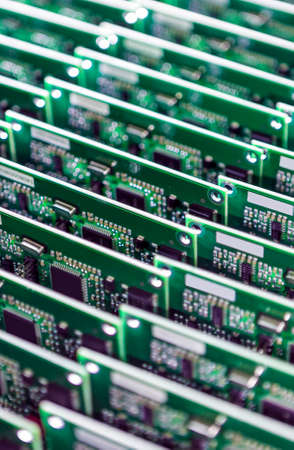 printed circuit: Lot of Ready Produced Printed Circuit Baords Packed Together Close. Vertical Image Stock Photo