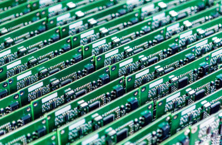 electrolytic: Lots of Printed Circuit Boards With Mounted and Soldered Componentry Arranged in Rows Together. Horizontal Image Stock Photo