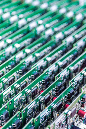 printed circuit: Lots of Printed Circuit Boards With Mounted and Soldered Componentry Arranged in Rows Together. Vertical Shot Editorial