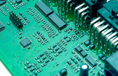 Closeup of Printed Circuit Board with Mounted Components. Horizontal Image Orientation