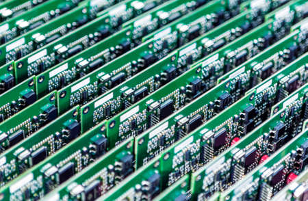 Lots of Printed Circuit Boards With Mounted and Soldered Componentry Arranged in Rows Together. Horizontal Image Stock Photo