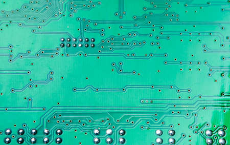 printed circuit: Printed Circuit Board Placed Reversed with Soldered Leads Made Visible. Horizontal Image Orientation