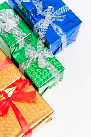 against white: Celebration Concepts. Many Colorful Wrapped Up Gift Boxes Standing In Line Together. Against White. Above View. Vertical Image Orientation