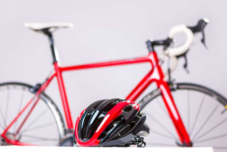 bicycle race: Cycling Safety Concept. Road Bike Protection Helmet in Front of Professional Road Bike. Horizontal Image Composition Stock Photo