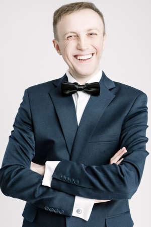 against white: Portrait of Happy Smiling Caucasian Handsome Man in Blue Suite Against White. Vertical Shot