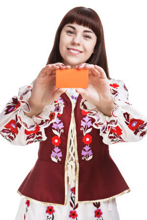 demonstrating: Young Caucasian Brunette Female Holding and Demonstrating Blank Card in Front . Against White. Vertical Shot