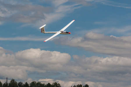 80th: Minsk, Belarus-June 21, 2014: Glider in Air During Aviation Sport Event Dedicated to the 80th Anniversary of DOSAAF Foundation in Minsk on June 21, 2014 in Minsk, Republic of Belarus