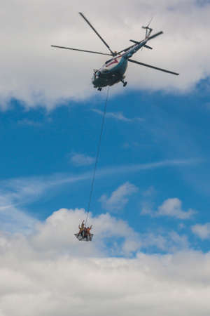 80th: Minsk, Belarus-June 21, 2014: Staff of Ministry of Emergency Situations Performing Air Elements on MI-8MT Helicopter During Aviation Sport Event Dedicated to the 80th Anniversary of DOSAAF Foundation in Minsk on June 21, 2014 in Minsk, Republic of Belarus