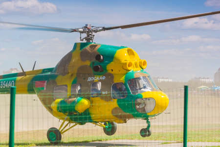 pilotage: Minsk, Belarus-June 21, 2014: MI-2 Helicopter on Air During Aviation Sport Event Dedicated to the 80th Anniversary of DOSAAF Foundation in Minsk on June 21, 2014 in Minsk, Republic of Belarus