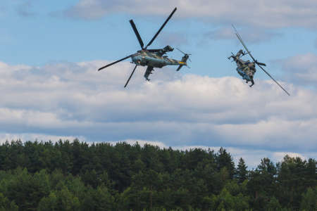 80th: Minsk, Belarus-June 21, 2014: MI-24 Helicopter on Air During Aviation Sport Event Dedicated to the 80th Anniversary of DOSAAF Foundation in Minsk on June 21, 2014 in Minsk, Republic of Belarus
