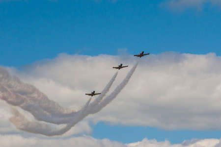 rus: Minsk, Belarus-June 21, 2014: Acrobatic Stunt Planes RUS of Aero L-159 ALCA on Air During Aviation Sport Event Dedicated to the 80th Anniversary of DOSAAF Foundation in Minsk on June 21, 2014 in Minsk, Republic of Belarus