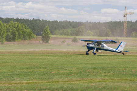 landing strip: Minsk, Belarus-June 21, 2014: Airplane PZL 104 Wilga on Takeoff and Landing Strip In Front of Spectators During Aviation Sport Event Dedicated to the 80th Anniversary of DOSAAF Foundation in Minsk on June 21, 2014 in Minsk, Republic of Belarus