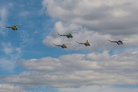 80th: Minsk, Belarus-June 21, 2014: Team of MI-2 Helicopters Performing Elements in Air In Front of Spectators During Aviation Sport Event Dedicated to the 80th Anniversary of DOSAAF Foundation in Minsk on June 21, 2014 in Minsk, Republic of Belarus