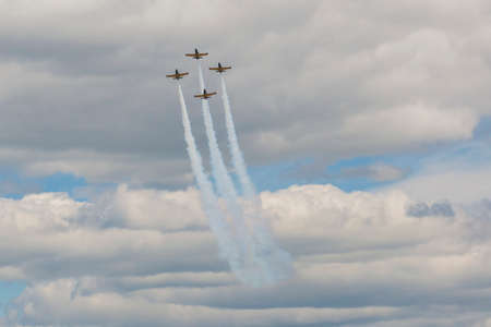 80th: Minsk, Belarus-June 21, 2014: Acrobatic Stunt Planes of Aero L-159 ALCA on Air During Aviation Sport Event Dedicated to the 80th Anniversary of DOSAAF Foundation in Minsk on June 21, 2014 in Minsk, Republic of Belarus