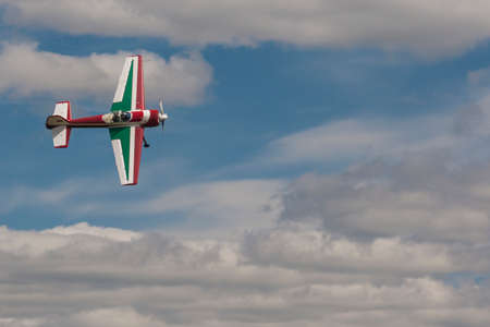 80th: Minsk, Belarus-June 21, 2014: SU-26M Acrobatics Stunt Plane Performing Elements in Air During Aviation Sport Event Dedicated to the 80th Anniversary of DOSAAF Foundation in Minsk on June 21, 2014 in Minsk, Republic of Belarus