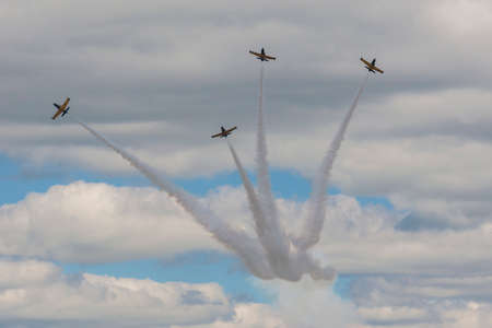 80th: Minsk, Belarus-June 21, 2014: Acrobatic Stunt Planes RUS of Aero L-159 ALCA on Air During Aviation Sport Event Dedicated to the 80th Anniversary of DOSAAF Foundation in Minsk on June 21, 2014 in Minsk, Republic of Belarus