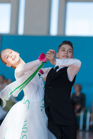 liana: Minsk, Belarus-April 3, 2016: Panasyuk Maksim and Belyankina Liana Perform Juvenile-1 Standard Program on the IDSA Championship Kinezis Star Cup � 2016 in April 3, 2016 in Minsk, Republic of Belarus Editorial