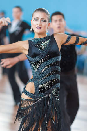 latinamerican: Minsk, Belarus-April 3, 2016: Silich Sergey and Borovskaya Olga Perform Youth Latin-American Program on IDSA Championship Kinezis Star Cup - 2016 in April 3, 2016 in Minsk, Republic of Belarus Editorial