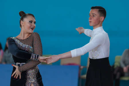 latinamerican: Minsk, Belarus-April 3, 2016: Unidentified dance couple Performs Juvenile-2 Latin-American Program on IDSA Championship Kinezis Star Cup - 2016 in April 3, 2016, Minsk, Republic of Belarus