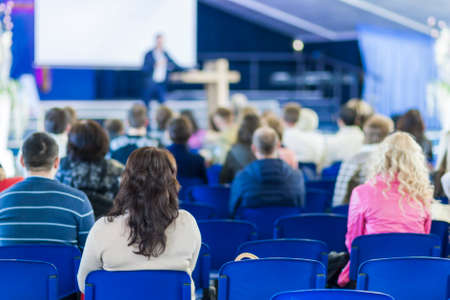 lecturer: Lecturer Speaking In front of the Large Group of People. Horizontal Image Composition Stock Photo