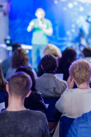 listeners: Male Professional Lecturer Speaking In front of the People. Horizontal Image Composition. Vertical Image Orientation Stock Photo