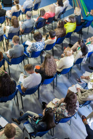 People Sitting in Lines on the Meeting or Conference. Vertical Image