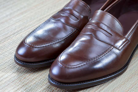 loafer: Pair of Stylish and Fashinable Brown Penny Loafer Shoes.Horizontal Image Orientation