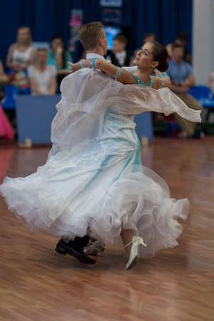 aleksander: Minsk, Belarus-May 28, 2016: Levkovich Aleksander and Bugakova Evelina Perform Youth-2 Standard Program on National Championship of the Republic of Belarus in May 28, 2016 in Minsk, Belarus