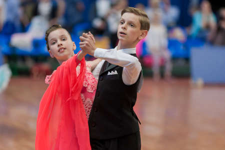 national championship: Minsk, Belarus-May 28, 2016: Gubeyko Aleksand and Yasevich Angelina Perform Juvenile-1 Standard European Program on National Championship of the Republic of Belarus in May 28, 2016 in Minsk, Republic of Belarus