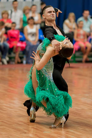 Minsk, Belarus –May 28, 2016: Kitcun Andrey and Krepchuk Yuliya Perform Adult Latin-American Program on National Championship of the Republic of Belarus in May 28, 2016 in Minsk, Belarus