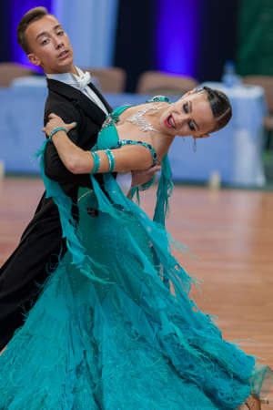 national championship: Minsk, Belarus –May 28, 2016: Unidentified Dance Couple Performs Juvenile-1 Standard European Program on National Championship of the Republic of Belarus in May 28, 2016 in Minsk, Republic of Belarus Editorial
