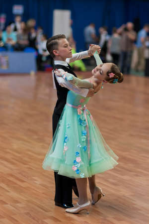 national championship: Minsk, Belarus May 28, 2016: Unidentified Dance Couple Performs Juvenile-1 Standard European Program on National Championship of the Republic of Belarus in May 28, 2016 in Minsk, Republic of Belarus Editorial