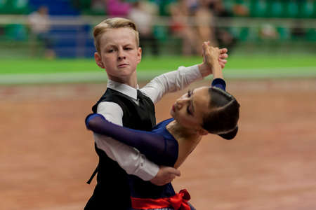 national championship: Minsk, Belarus -May 29, 2016: Prahov Ivan and Sackevich Ekaterina Perform Juvenile-1 Standard European Program on National Championship of the Republic of Belarus in May 29, 2016 in Minsk, Republic of Belarus Editorial