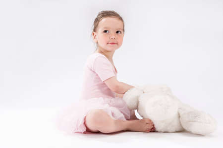 plush toy: Cute Little Caucasian Child with Big Plush Toy. Sitting and Looking Upwards. Horizontal Image Orientation