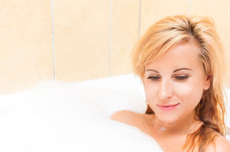 Healthlife and Wellness Concepts and Ideas. Attractive Caucasian Female Enjoying Bath with Aroma Foam.Horizontal Shot
