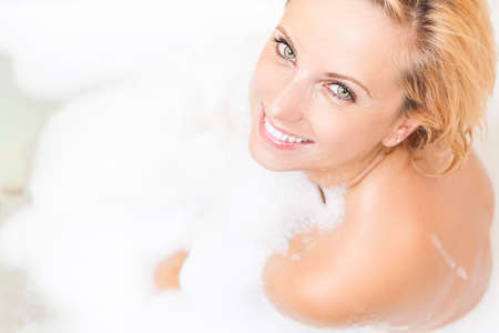 relaxion: Portrait of Caucasian Relaxing Woman in Bath Shower. Much Foam Used.Horizontal Image Composition