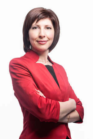 Businesswoman in Red Suit Posing Against White Background. Vertical Image Standard-Bild