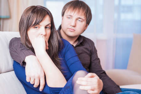 difficulties: Family Concepts. Young Caucasian Couple in Troubles Having Difficulties and Depressed.Horizontal Shot