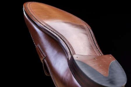 loafers: Footwear Ideas. Downward Side of Penny Loafer Natural Leather Sole. Closeup Shot. Horizontal Image Composition Stock Photo