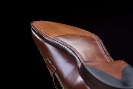 loafer: Downward Side of Penny Loafer Natural Leather Sole. Closeup Shot. Horizontal Image Composition