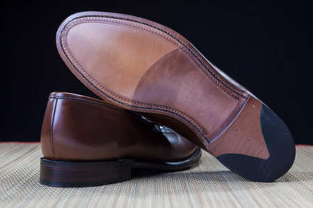 loafer: Footwear Concepts and Ideas. Backside View of Penny Loafer Natural Leather Sole. Horizontal Image Orientation