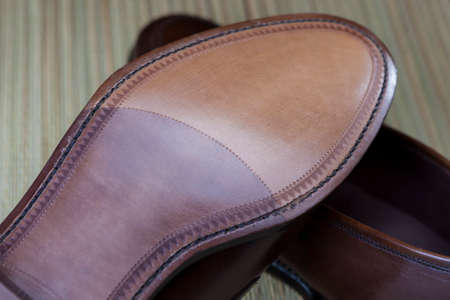 loafer: Footwear Concepts. Backside View of Penny Loafer Natural Leather Sole. Horizontal Image Stock Photo