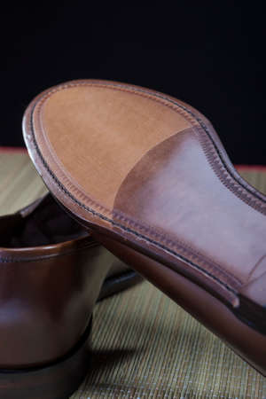loafer: Footwear Concepts. Backside View of Penny Loafer Natural Leather Sole. Vertical Image