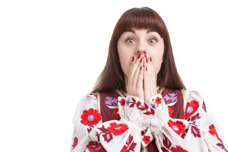 boca cerrada: Natural Retrato de asustado caucásico Femenino. Posando con las manos Cerrando la boca. Contra el blanco puro. Horizontal Orientación de la imagen Foto de archivo