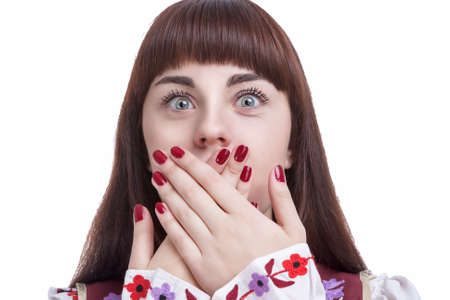 exclaiming: Human Feelings and Emotions Concepts. Young Caucasian Brunette Closing Her Mouth With Folded Palms. Against White Background. Horizontal Image Concept
