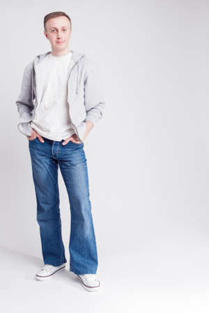 against white: Full Length Portrait of Happy Caucasian Man in Casual Clothing Posing Against White Background. Vertical Image Composition