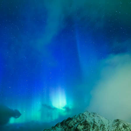 Amazing Picturesque Unique Nothern Lights Aurora Borealis Over Lofoten Islands in Nothern Part of Norway. Over the Polar Circle. Square Image Orientation Stock Photo