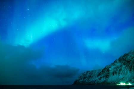 Amazing and Unique Nothern Lights Aurora Borealis Over Lofoten Islands in Norway, Over the Polar Circle. Horizontal Shot Stock Photo